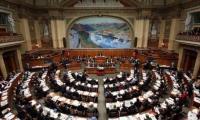 Der Nationalratssaal im Bundeshaus: Dort können die Kantone Wallis und Zürich bei den Parlamentswahlen 2015 mit je einem zusätzlichen Sitz rechnen.